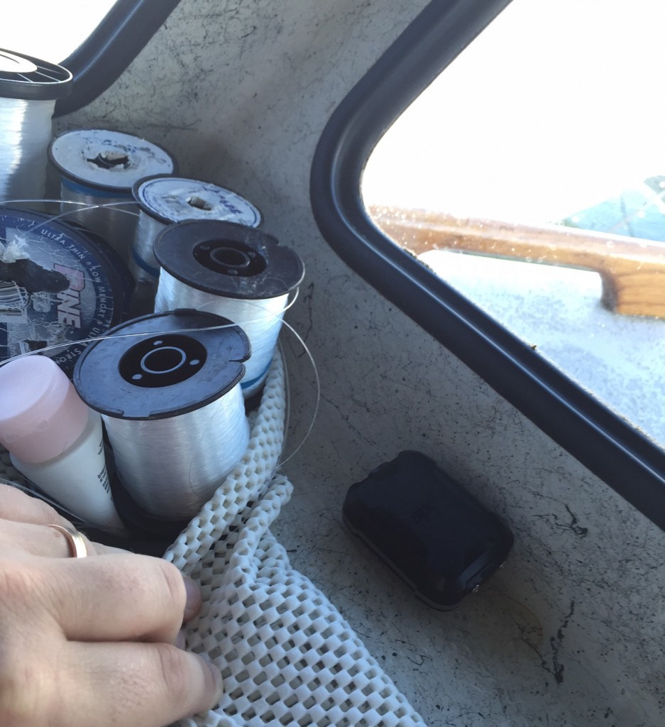 The SPOT Trace is placed on my boat on the dash near a window, out of sight behind some spools of line.