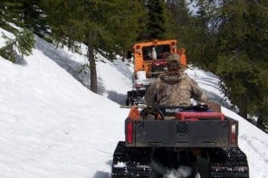 York Outfitters taking clients on a hunt in the Bitterroot Selway Wilderness on 4wd vehicles and their snow groomer