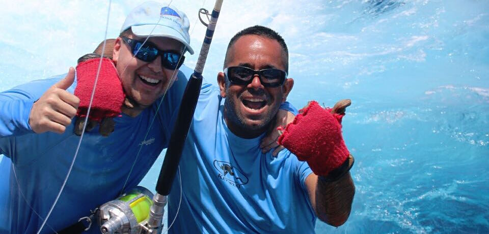 Fly Navarro with a student at marlin university where Fly teaches people how to fish for Marlin