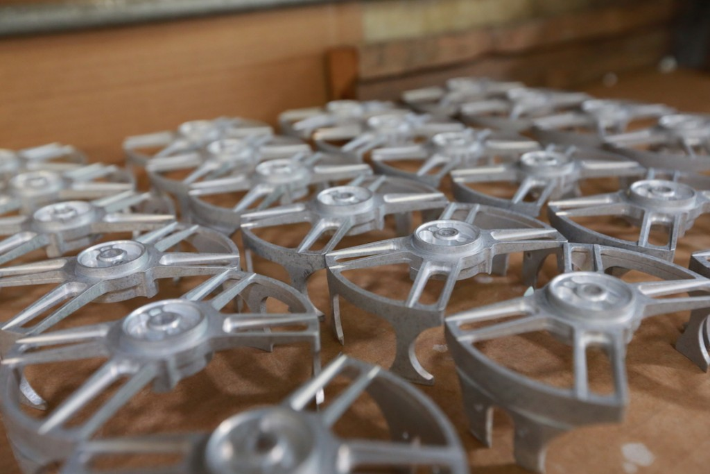 Table full of the new nautilus reels x-series before they are finished