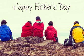 Fathers day concept, Family enjoying view of Edinburgh from top of Arthurs seat, ancient volcano, Scotland, UK