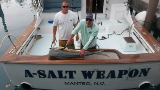 a salt weapon sportfishing with captain dennis endee filleting a big mahi mahi