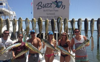 happy customers after a day of fishing with captain aaron brower on the buzz on in islamorada florida