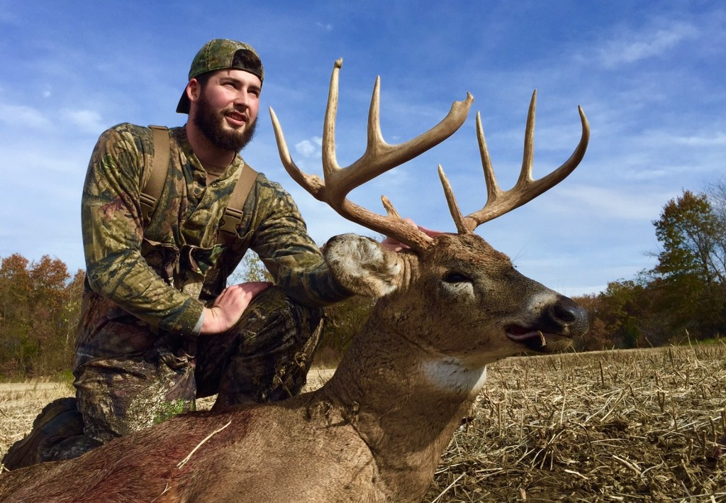 RackNine photo featuring a happy client who has harvested a mature buck