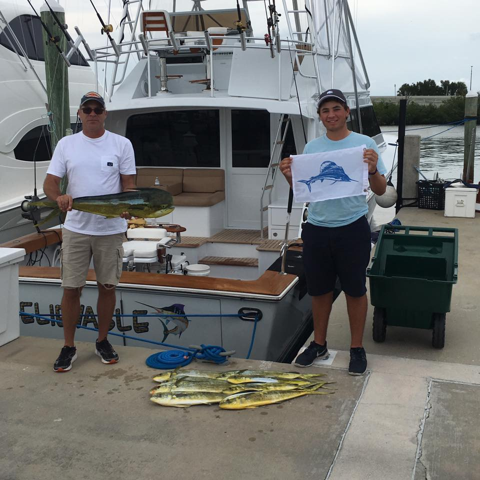 This happy family scored dorado and marlin with Stuart Big Game Fishing