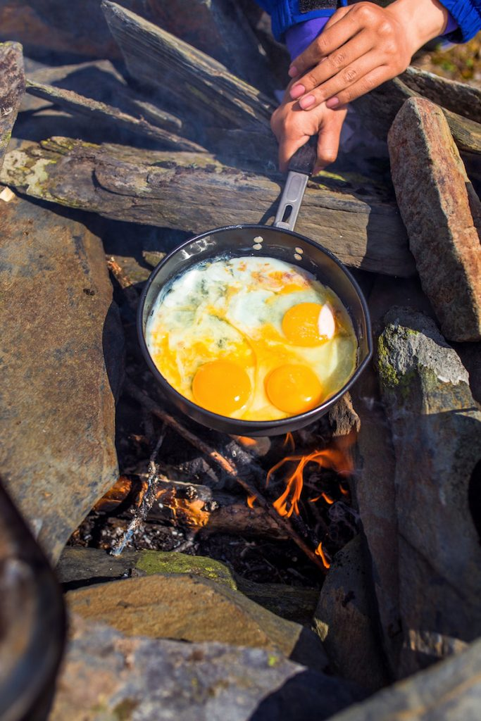 Manage the heat while campfire cooking