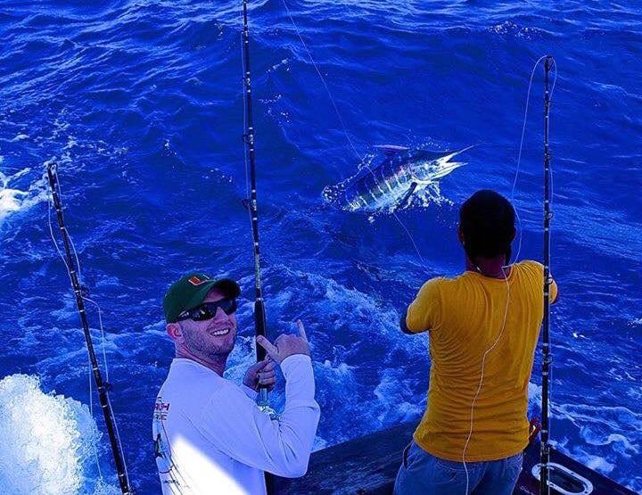 A happy Stuart Big Game Fishing client landing a marlin
